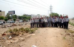 Protesting against the road side dumps spreading diseases